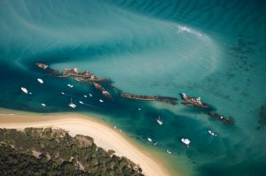 """Aerial view of the Tangalooma Wrecks at Moreton Island, Queensland, Australia"""